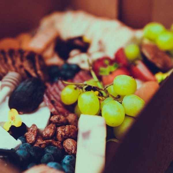 Grazing box featuring cheese, crackers, fruit & nuts